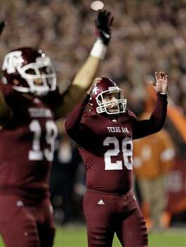 Texas A&M kicker Randy Bullock (28) reacts after kicking a 52-yard field goal during the second quarter of an NCAA college football game against Texas, Thursday, Nov. 24, 2011, in College Station, Texas. (AP Photo/David J. Phillip) Photo: Associated Press