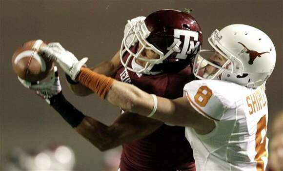Texas A&M defensive back Trent Hunter, left, breaks up a pass intended for Texas wide receiver Jaxon Shipley (8) during the second quarter of an NCAA college football game, Thursday, Nov. 24, 2011, in College Station, Texas. (AP Photo/David J. Phillip) Photo: Associated Press