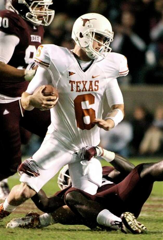 Texas quarterback Case McCoy (6) is sacked by Texas A&M linebacker Steven Jenkins during the second quarter of an NCAA college football game, Thursday, Nov. 24, 2011, in College Station, Texas. (AP Photo/Dave Einsel) Photo: Associated Press