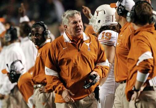 Texas head coach Mack Brown reacts during the second quarter of an NCAA college football game against Texas A&M, Thursday, Nov. 24, 2011, in College Station, Texas. (AP Photo/Dave Einsel) Photo: Associated Press