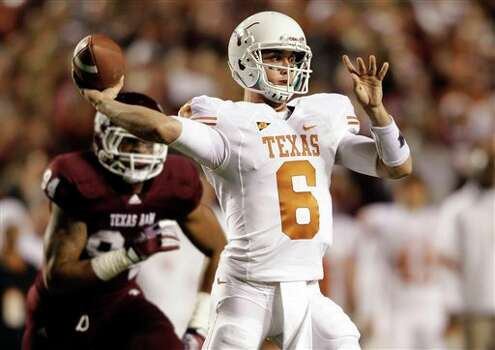 Texas quarterback Case McCoy (6) throws a pass during the first quarter of an NCAA college football game against Texas A&M, Thursday, Nov. 24, 2011, in College Station, Texas. (AP Photo/David J. Phillip) Photo: Associated Press