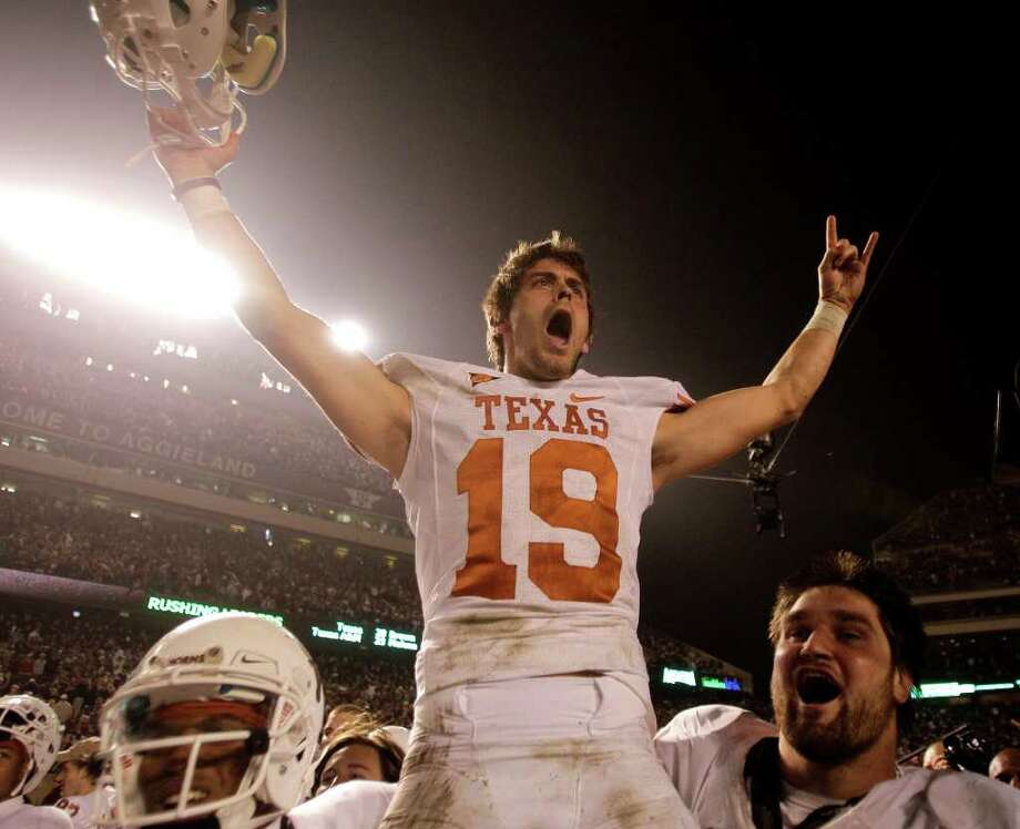 Texas kicker Justin Tucker is carried off the field by his teammate after kicking a game-winning 40-yard field goal to beat Texas A&M as time expired in regulation. Photo: Brett Coomer, Houston Chronicle / © 2011 Houston Chronicle