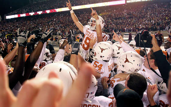 SPORTS   Longhorn place kicker Justin Tucker is lifted out of a dogpile after teammates covered him in celebration after he kicked the winning field goal as UT beats A&M 27-25 at Kyle Field in College Station on November 24, 2011.  Tom Reel/Staff Photo: TOM REEL, SAN ANTONIO EXPRESS-NEWS / © 2011 San Antonio Express-News