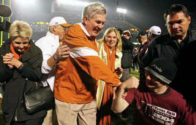 SPORTS   An Aggie fan bows down in ceremonial concession to Mack Brown as the Longhorn coach walks off the field as Texas A&M hosts UT at Kyle Field in College Station on November 24, 2011.  Tom Reel/Staff Photo: TOM REEL, SAN ANTONIO EXPRESS-NEWS / © 2011 San Antonio Express-News
