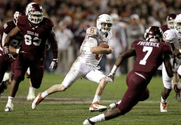 Texas quarterback Case McCoy (6) breaks away from Texas A&M defensive back Terrence Frederick (7) for a long run to set up a game-winning field goal for the Longhorns during the fourth quarter of an NCAA college football game at Kyle Field Thursday, Nov. 24, 2011, in College Station. Texas beat Texas A&M 27-25. Photo: Brett Coomer, Houston Chronicle / © 2011 Houston Chronicle