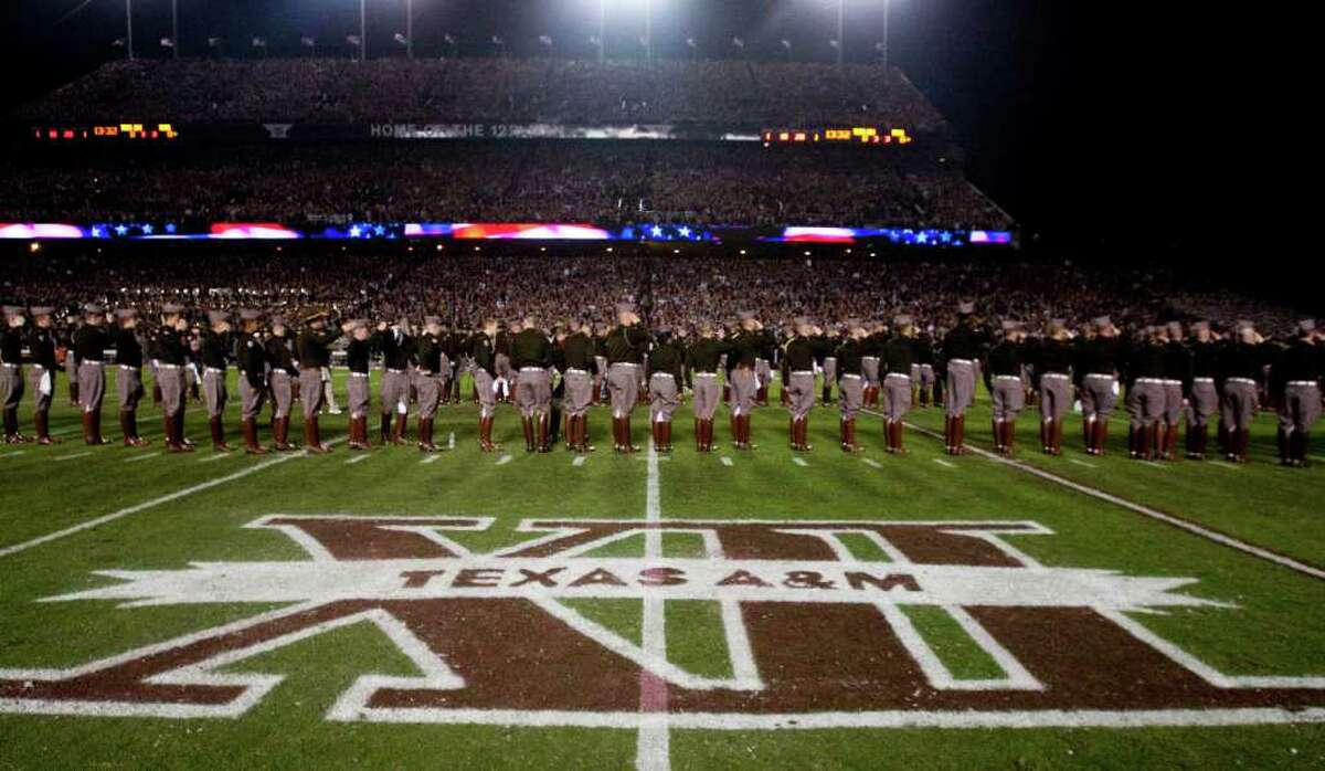 The Texas A&M Corps of Cadets line up on the field before an NCAA college football game between Texas A&M and Texas at Kyle Field Thursday, Nov. 24, 2011, in College Station. ( Brett Coomer / Houston Chronicle )