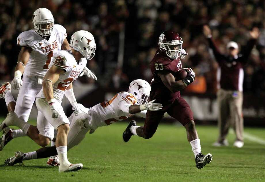 Texas A&M running back Ben Malena (23) runs past Texas cornerback Carrington Byndom (23) during the first quarter of an NCAA college football game at Kyle Field Thursday, Nov. 24, 2011, in College Station. ( Brett Coomer / Houston Chronicle ) Photo: Brett Coomer / © 2011 Houston Chronicle