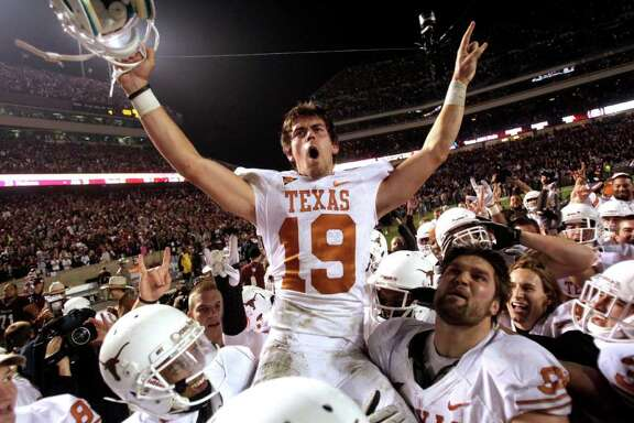 Texas kicker Justin Tucker (19) is carried off the field by his teammate after kicking a 40-yard field goal to beat Texas A&M during the fourth quarter of an NCAA college football game at Kyle Field Thursday, Nov. 24, 2011, in College Station. Texas beat Texas A&M 27-25.