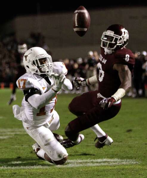 Texas cornerback Adrian Phillips (17) breaks up a pass intended for Texas A&M wide receiver Jeff Ful