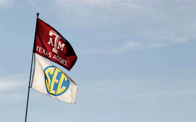 Texas A&M and Southeastern Conference flags fly over the tailgating area before an NCAA college football game between Texas and Texas A&M at Kyle Field Thursday, Nov. 24, 2011, in College Station. Photo: Brett Coomer, Houston Chronicle / © 2011 Houston Chronicle