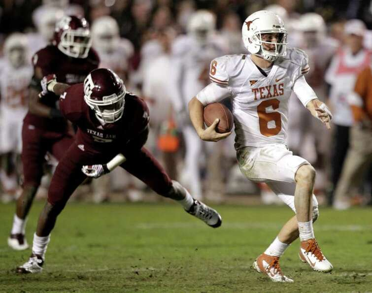Texas quarterback Case McCoy (6) breaks away from Texas A&M defensive back Terrence Frederick (7) fo