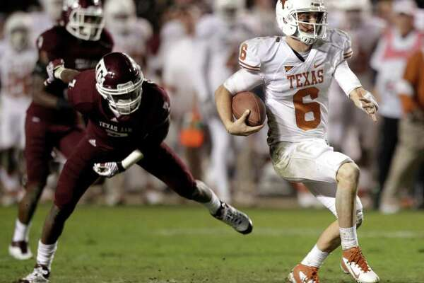 Texas quarterback Case McCoy (6) breaks away from Texas A&M defensive back Terrence Frederick (7) for a long run to set up a game-winning field goal for the Longhorns during the fourth quarter of an NCAA college football game at Kyle Field Thursday, Nov. 24, 2011, in College Station. Texas beat Texas A&M 27-25.
