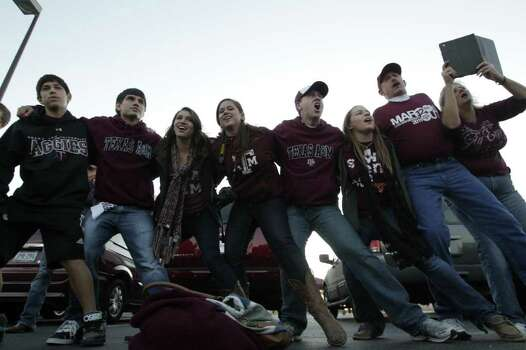 Texas A&M fans sing as they tailgate before an NCAA college football game between Texas and Texas A&M at Kyle Field Thursday, Nov. 24, 2011, in College Station. Photo: Brett Coomer, Houston Chronicle / © 2011 Houston Chronicle