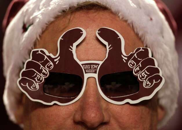 Texas A&M fan Tom Mayer, of The Woodlands, dons a pair of Gig 'Em glasses during the first quarter of an NCAA college football game between the Aggies and Texas at Kyle Field Thursday, Nov. 24, 2011, in College Station. Photo: Brett Coomer, Houston Chronicle / © 2011 Houston Chronicle