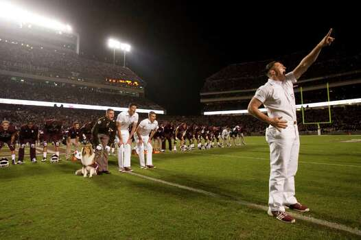 The Texas A&M yell leaders cheer before the first quarter of an NCAA college football game between Texas A&M and Texas at Kyle Field Thursday, Nov. 24, 2011, in College Station. Photo: Brett Coomer, Houston Chronicle / © 2011 Houston Chronicle