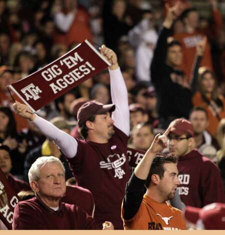 Texas A&M and Texas fans cheer during the first quarter of an NCAA college football game at Kyle Field Thursday, Nov. 24, 2011, in College Station. Photo: Brett Coomer, Houston Chronicle / © 2011 Houston Chronicle
