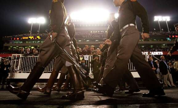 Texas A&M march into the stadium before an NCAA college football game between Texas A&M and Texas A&M at Kyle Field Thursday, Nov. 24, 2011, in College Station. Photo: Brett Coomer, Houston Chronicle / © 2011 Houston Chronicle