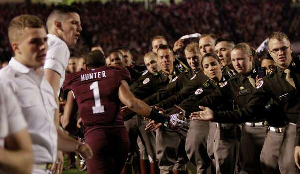 Texas A&M defensive back Trent Hunter (1) runs through the Corps of Cadets before an NCAA college football game between Texas A&M and Texas at Kyle Field Thursday, Nov. 24, 2011, in College Station. Photo: Brett Coomer, Houston Chronicle / © 2011 Houston Chronicle