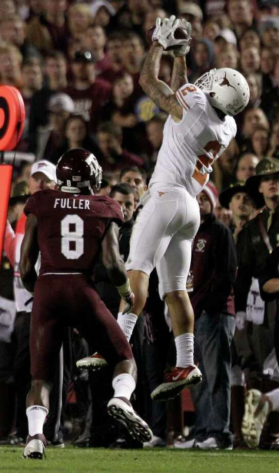 Texas cornerback A.J. White (2) leaps up to intercept a pass intended for Texas A&M wide receiver Jeff Fuller (8) during the third quarter of an NCAA college football game at Kyle Field Thursday, Nov. 24, 2011, in College Station. Texas beat Texas A&M 27-25. Photo: Brett Coomer, Houston Chronicle / © 2011 Houston Chronicle