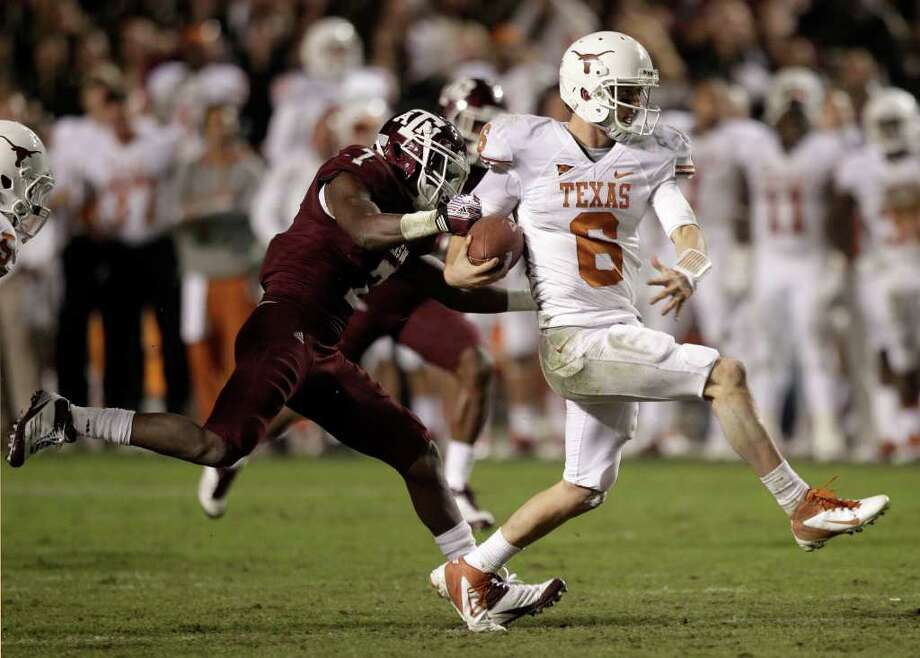 BRETT COOMER : CHRONICLE PULLING AHEAD: UT quarterback Case McCoy breaks free for a crucial 25-yard run during the Longhorns' game-winning drive Thursday night. Photo: Brett Coomer / © 2011 Houston Chronicle