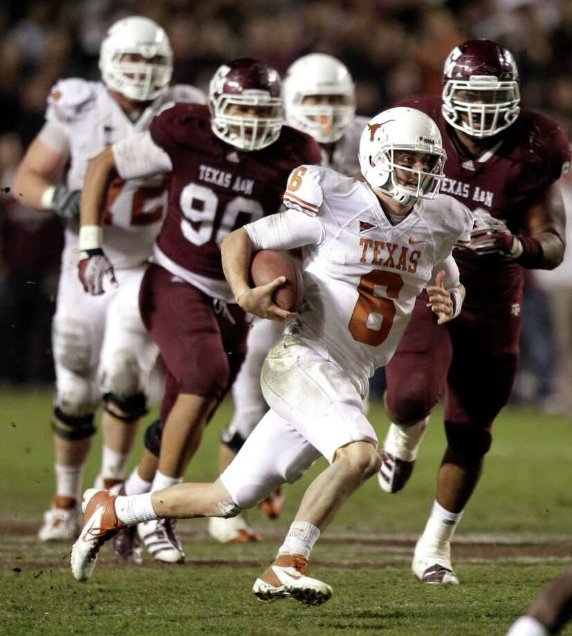 Texas quarterback Case McCoy (6) breaks away from Texas A&M defensive back Terrence Frederick (7) for a long run to set up a game-winning field goal for the Longhorns during the fourth quarter of an NCAA college football game at Kyle Field Thursday, Nov. 24, 2011, in College Station. Texas beat Texas A&M 27-25. ( Brett Coomer / Houston Chronicle ) Photo: Brett Coomer / © 2011 Houston Chronicle