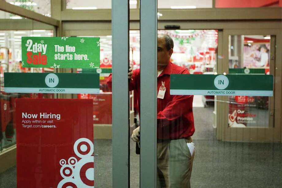 At the stroke of midnight, the doors are opened for Black Friday sales at the Target Story on Sawyer Street near the downtown on Thanksgiving night, Friday, Nov. 25, 2011, in Houston. Photo: Smiley N. Pool, Houston Chronicle / © 2011 Houston Chronicle