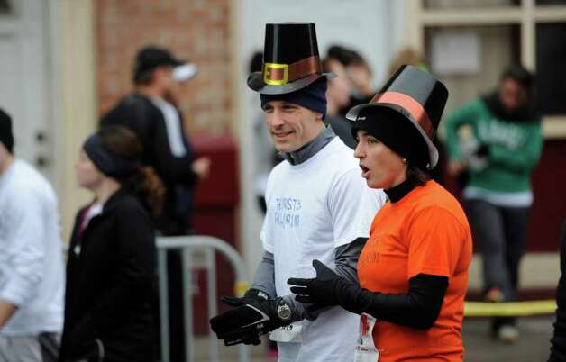 Bill Paczkowski, left and Erin DeMarco participate in the 5K race during the Turkey Trot in Troy, N.Y. Nov. 24, 2011   (Skip Dickstein / Times Union) Photo: SKIP DICKSTEIN / 071120015A