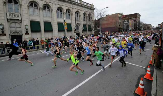The start of the 5K race during the Turkey Trot in Troy, N.Y. Nov. 24, 2011.  7100 entrants took to the streets for the race.     (Skip Dickstein / Times Union) Photo: SKIP DICKSTEIN / 071120015A