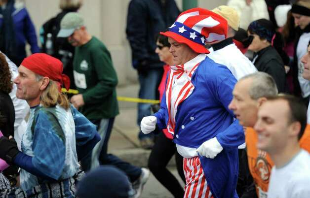 Matt Huntley of Averill Park dressed as Uncle Sam tries his hand at the 5K race during the Turkey Trot in Troy, N.Y. Nov. 24, 2011   (Skip Dickstein / Times Union) Photo: SKIP DICKSTEIN / 071120015A