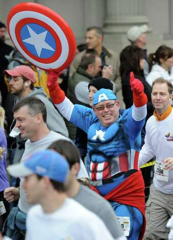 Captain America makes an appearance at the 5K race during the Turkey Trot in Troy, N.Y. Nov. 24, 2011   (Skip Dickstein / Times Union) Photo: SKIP DICKSTEIN / 071120015A