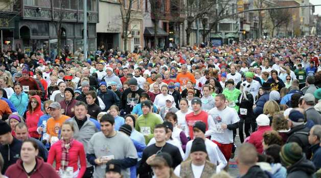 Some of the 7100 entrants in the 5K race during the Turkey Trot in Troy, N.Y. Nov. 24, 2011   (Skip Dickstein / Times Union) Photo: SKIP DICKSTEIN / 071120015A