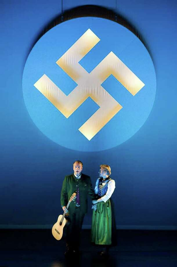 """In this photo taken Wednesday, Oct. 19, 2011, Wietske van Tongeren, right,  in the role of  Maria Rainer and Uwe Kroeger as Captain Georg von Trapp, left, perform during a dress rehearsal for the musical """"The Sound of Music"""" by Richard Rogers in Salzburg, Austria. """"The Sound of Music,"""" is playing for the first time in this haughty city of opera lovers. (AP Photo/Kerstin Joensson) Photo: Kerstin Joensson / AP"""