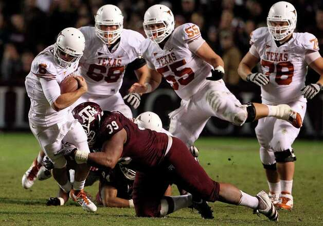 SPORTS   Case McCoy breaks free in the first half as Texas A&M hosts UT at Kyle Field in College Station on November 24, 2011.  Tom Reel/Staff Photo: TOM REEL, SAN ANTONIO EXPRESS-NEWS / © 2011 San Antonio Express-News