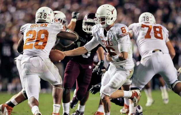 Case McCoy hands off to Malcolm Brown as Texas A&M hosts UT at Kyle Field in College Station on November 24, 2011.  Photo: TOM REEL, SAN ANTONIO EXPRESS-NEWS / © 2011 San Antonio Express-News
