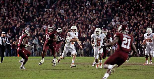 SPORTS   Case McCoy opens up the field with seconds remaining to set up a winning field goal as Texas A&M hosts UT at Kyle Field in College Station on November 24, 2011.  Tom Reel/Staff Photo: TOM REEL, SAN ANTONIO EXPRESS-NEWS / © 2011 San Antonio Express-News