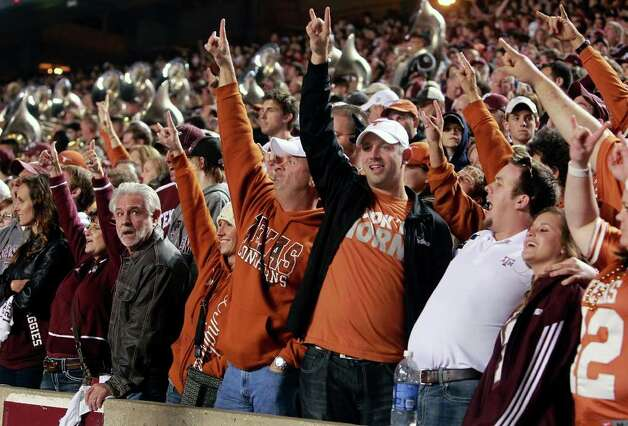 SPORTS   Longhorn fans and Aggies cheer together on the student side of the stadium as Texas A&M hosts UT at Kyle Field in College Station on November 24, 2011.  Tom Reel/Staff Photo: TOM REEL, SAN ANTONIO EXPRESS-NEWS / © 2011 San Antonio Express-News
