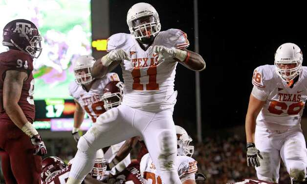 SPORTS   Longhorn running back Cody Johnson celebrates his go ahead touchdown as Texas A&M hosts UT at Kyle Field in College Station on November 24, 2011.  Tom Reel/Staff Photo: TOM REEL, SAN ANTONIO EXPRESS-NEWS / © 2011 San Antonio Express-News