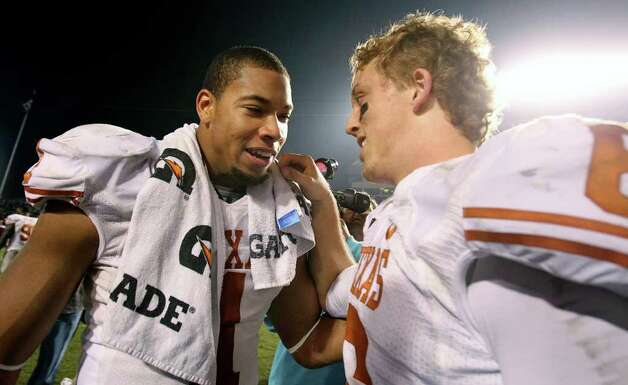 SPORTS   UT quarterback Case McCoy is congratulated by Keenan Robinson as UT beats A&M at Kyle Field in College Station on November 24, 2011.  Tom Reel/Staff Photo: TOM REEL, SAN ANTONIO EXPRESS-NEWS / © 2011 San Antonio Express-News