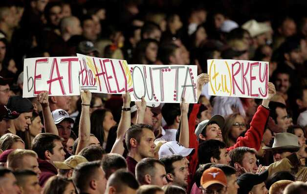 SPORTS   Fans display a holiday message as Texas A&M hosts UT at Kyle Field in College Station on November 24, 2011.  Tom Reel/Staff Photo: TOM REEL, SAN ANTONIO EXPRESS-NEWS / © 2011 San Antonio Express-News