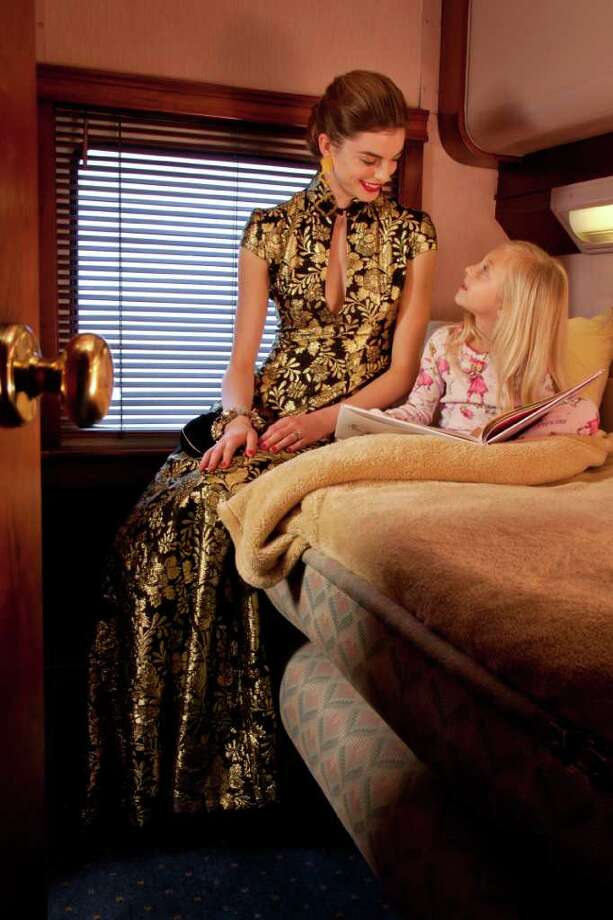 Heather Hausman of Page.713 wears a Jerri Moore gown, jerrimoore.com. Bracelet and vintage purse, Cheeky Vintage. Earrings, Neiman Marcus. McCartney Bisgard wears the Very Fairy Princess pajamas (a set with the book), Saks Fifth Avenue. Shot on location aboard the Evelyn Henry and Warren R. Henry, vintage train cars available for charter from Patrick Henry Promotions. Styling: Dawn Bell, with assistant Betty Gonzalez. Hair and makeup: Carol Wagener. Photographed for the December Gloss issue on Wednesday, Nov. 2, 2011, in Houston. ( Smiley N. Pool / Houston Chronicle ) Photo: Smiley N. Pool / © 2011  Houston Chronicle