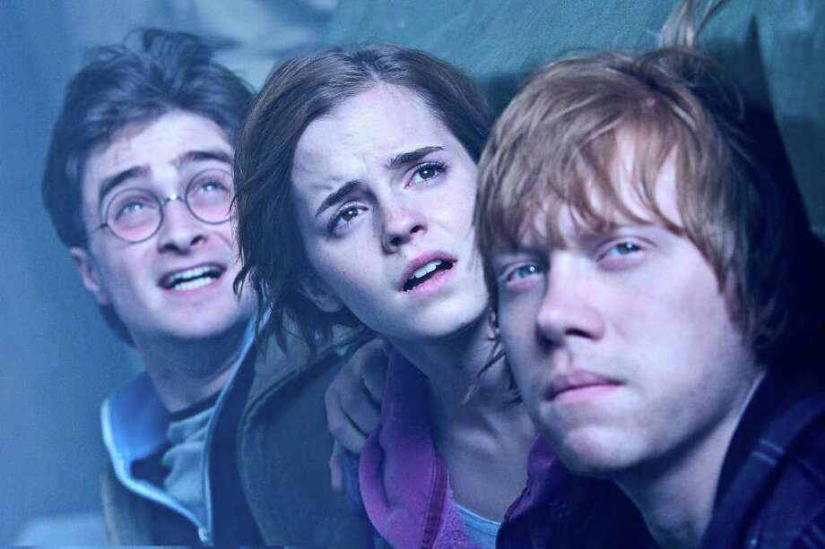 """Daniel Radcliffe as Harry Potter, from left, Emma Watson as Hermione Granger and Rupert Grint as Ron Weasley in Warner Bros. Pictures' fantasy adventure """"Harry Potter and the Deathly Hallows - Part 2,"""" a Warner Bros. Pictures release. (Jaap Buitendijk/Courtesy Warner Bros. Pictures/MCT) Photo: HANDOUT / MCT"""