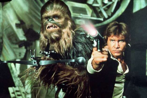 "Peter Mayhew as Chewbacca and Harrison Ford as Han Solo in ""Star Wars"" / handout CD"