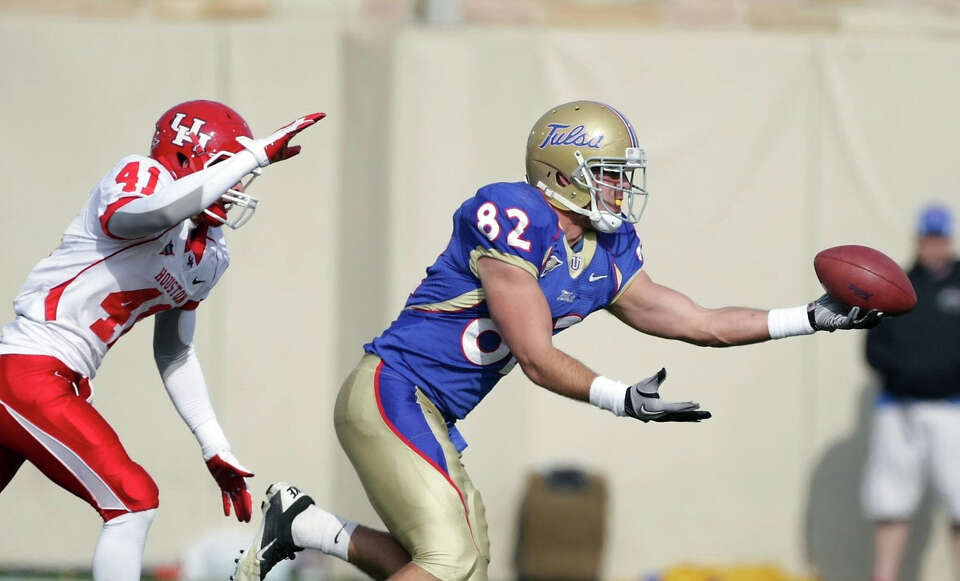 Tulsa tight end Clay Sears reaches for a pass as Nick Saenz defends.