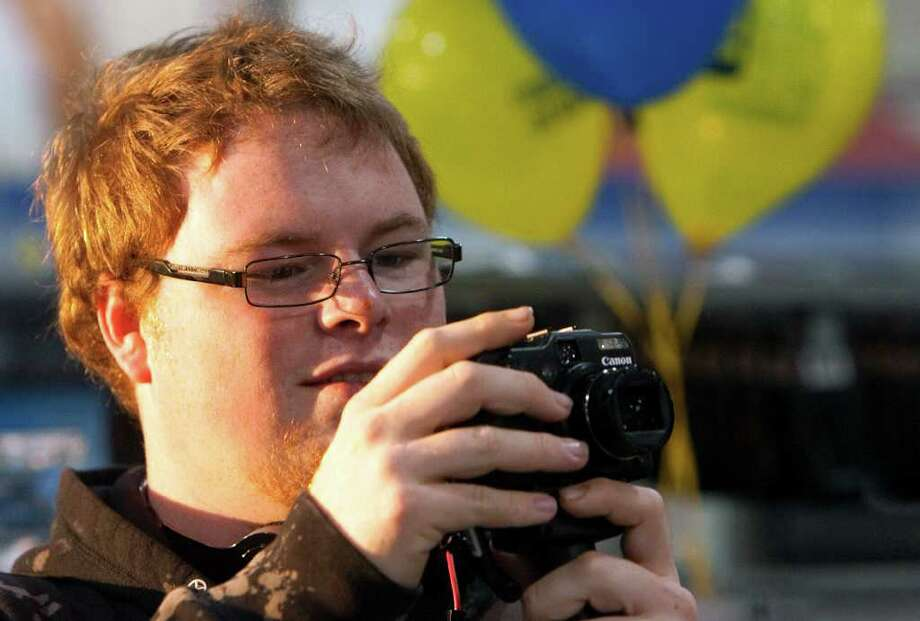 Chris Trantham looks at a camera during Black Friday at a Best Buy, Nov. 25, 2011, in Houston. (Cody Duty / Houston Chronicle) Photo: Cody Duty / © 2011 Houston Chronicle