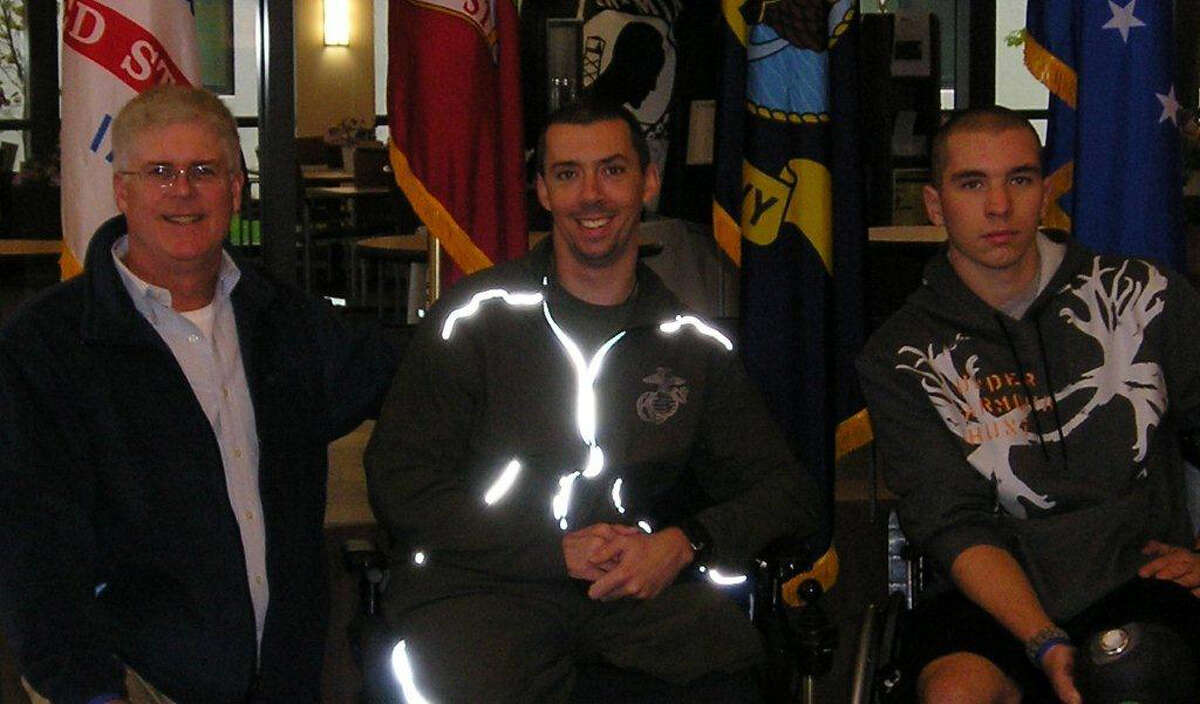 From left, Sticks for Soldiers chairperson Jim Tommins, and two of the 2011 honorees, USMC Sgt. Liam Dwyer and Army Pfc. Joshua Budd at the new Walter Reed National Military Medical Center in Bethesda Md. The Sticks for Soldiers lacrosse fundraiser takes place Saturday Nov. 26 at Fairfield Ludlowe.