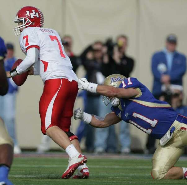 University of Houston quarterback Case Keenum (7) is sacked by University of Tulsa linebacker Alan D