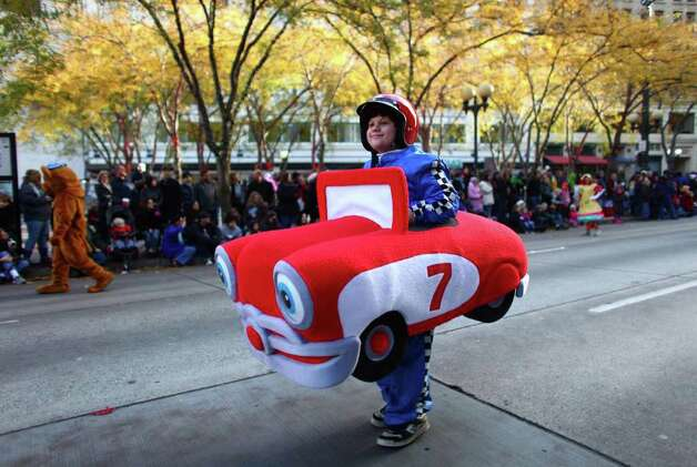 A participant wears a costume during the Macy's Holiday Parade on Friday in downtown Seattle. Crowds lined downtown streets to see the annual parade. Photo: JOSHUA TRUJILLO / SEATTLEPI.COM