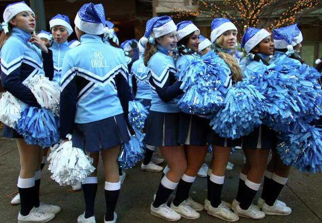 Interlake High School drill members try to keep warm during the Macy's Holiday Parade on Friday in downtown Seattle. Crowds lined downtown streets to see the annual parade. Photo: JOSHUA TRUJILLO / SEATTLEPI.COM