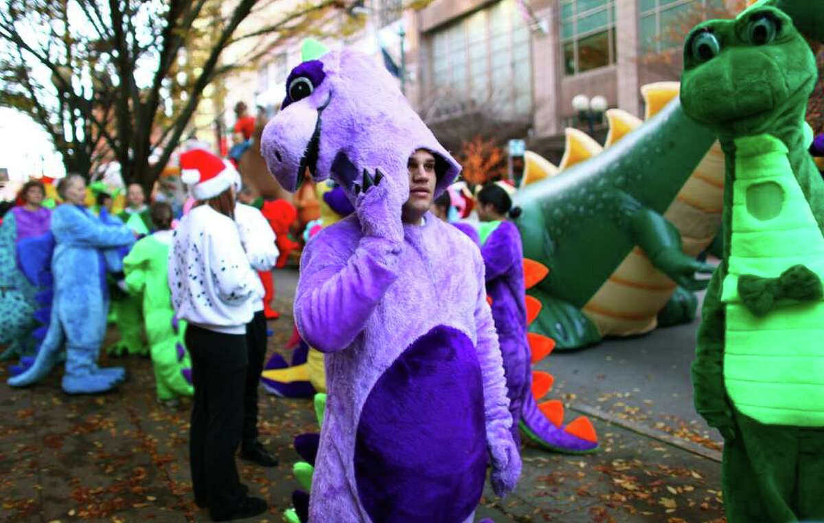 Participants wait for the beginning of the Macy's Holiday Parade on Friday, Nov. 25, 2011, in downtown Seattle. Crowds lined downtown streets to see the annual parade.