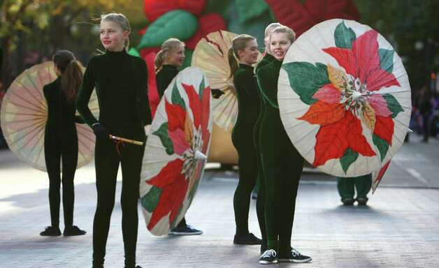 Participants perform in the Macy's Holiday Parade on Friday 1 in downtown Seattle. Crowds lined downtown streets to see the annual parade. Photo: JOSHUA TRUJILLO / SEATTLEPI.COM